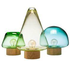 """Simple, elegant little glass and wood lamps by Norwegian designer Caroline Olsson for Magnor Glassverk. Inspired by the woods near Magnor Glassverk, """"skog"""" is the Norwegian word for forest."""