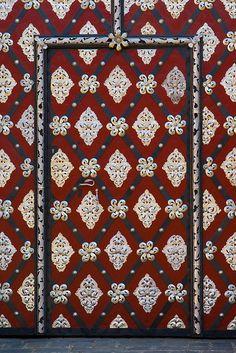 Red door. Metal details. Prague