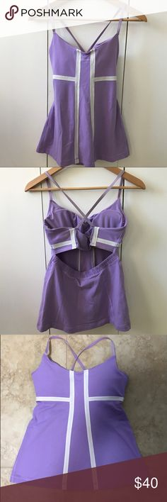 """Lululemon Mynah Lavender Purple Yoga Bra Tank Sz 8 Lululemon Athletica Mynah sleeveless athletic tank top in women's size 8. Lavender purple color with white piping along front and back. Built-in bra with removable, padded cups. Lightweight and stretchy material and stretchy spaghetti straps. Open back with center mesh detailing. Perfect for yoga, Pilates, or other workouts. 12.5"""" from armpit to armpit. 16"""" from bottom of armpit to bottom of hem. lululemon athletica Tops Tank Tops"""