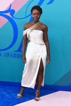 """Lupita Nyong'o - The Oscar winner accused Graziaof Photoshopping her natural hair for its latest magazine cover, editing out her ponytail and smoothing her strands """"to fit a more Eurocentric notion of what beautiful hair looks like,"""" she wroteon Twitter."""