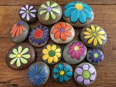 This pretty, little flower is hand painted on a rock collected from the shore of Lake Ontario.Easy Paint Rock For Try at Home (Stone Art & Rock PaintingTop Easy Rock Painting Ideas - I Love Painted Rocks Rock Painting Patterns, Rock Painting Ideas Easy, Rock Painting Designs, Rock Painting For Kids, Pebble Painting, Pebble Art, Stone Painting, Painting Flowers, Garden Painting