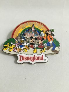 Disneyland Resort. Mickey & Friends. Souvenir Pin. This is a authentic Disney theme park souvenir pin. 2002 Rainbow. No scratches. Has discoloration on back. | eBay!