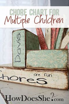 Cute, DIY Chore Chart For Multiple Kids - made out wood and scrapbook paper! LOVE it! Tutorial at howdoesshe.com