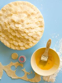 Pie Crust Ideas  There is no url for this one. But it's pretty self explanatory. Use any crust recipe and a cookie cutter. Then layer. Then brush with butter...