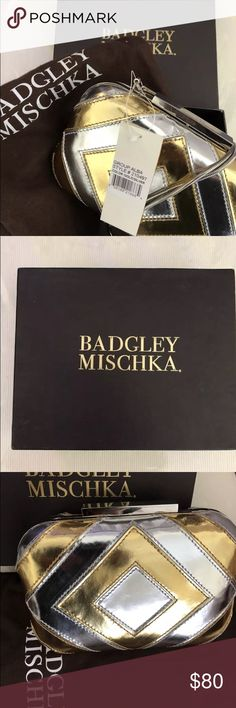 Badgley Mischka Clutch Alba Diamond Metallic Badgley Mischka Clutch Alba Diamond Metallic Gold and Silver. Brand new in Box and storage bag. Tags attached. Silver chain strap. Compare retail value (out of stock $177). Bags