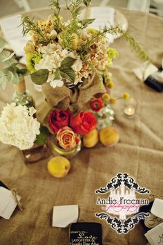 Peach themed tablescapes with white hydrangeas, peaches, and coral roses in burlap wrapped vase with brooch. Mismatched vintage china on burlap covered table.  Summer shabby chic barn wedding. Photography by Andie Freeman Photography www.TheAthensWeddingPhotographer.com Event design, floral, and planning by Wildflower Event Services www.WildflowerEventServices.com Venue:  Private property in Chickamauga, Ga Barn Wedding Inspiration, Holography, Coral Roses, White Hydrangeas, Centerpieces, Table Decorations, Event Services, Private Property, Table Arrangements