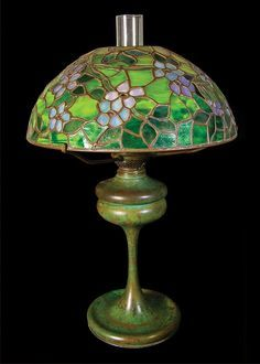 """Tiffany apple blossom lamp. SIGNED TIFFANY LAMP With 16"""" apple blossom shade, """"This lamp was originally an oil lamp and was later electrified, NY state origin, c. 1910."""", purple and green, base signed """"Tiffany Studios"""", shade marked """"Tiffany Studios, New York."""", 23"""" h, 8 1/4"""" dia base, (ex. Ed Clerk collection)."""