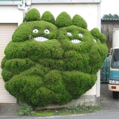 Tree art. My youngest daughter saw this image and giggled so now I look at the image and smile. While it's not exactly the garden style I prefer, it's a childlike heart that makes me appreciate it.