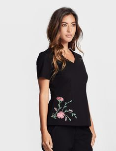 """""""The Embroidered Top in Black is a contemporary addition to women's medical scrub outfits. ShopJaanuufor scrubs, lab coats and other medical apparel."""""""