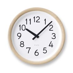 """Pinto Clock in Natural WoodClock 10"""" x D2"""" Natural  Made in Japan. Please allow 4-8 weeks to ship out and receive tracking. Contact us to see about expedited"""