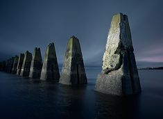WWII bunkers that look like ancient monoliths (pictured submarine defense boom off the ciast of Scotland)
