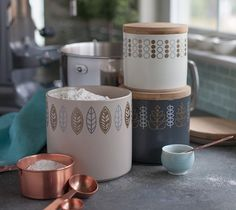 Scandinavian kitchen canisters by Lia Griffith. Make It Now with the Cricut Explore machine in Cricut Design Space.