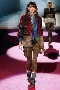 Dsquared² Fall 2015 \  Mountain man influenced fur suede mix jacket over denim shirt leather pocket pants.  Beaded earrlings.