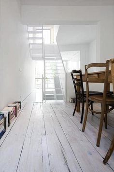 White room with brown chairs