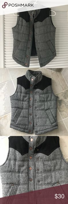 Grey wool tweed like puffer vest with black panel Brand new, never worn or washed. Super cute grey vest with top black panel and snap closure. Has tiny specks running throughout similar to tweed. Lined. Size small. Bronze buttons. Purchased from a local boutique. Ci Sono Jackets & Coats Vests