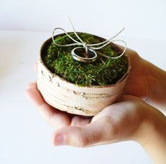 "A natural alternative to the classic wedding ring pillow! Create a soft ""pillow"" out of moss for the rings to rest on."