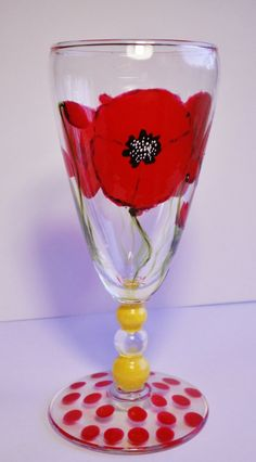 Red Poppies and polkadots  red & yellow wineglass by InkyDreamz, $21.00