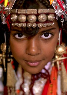 Tuareg girl wearing traditional jewelery.  Photo taken in Ghadames, Libya by Eric Lafforgue.