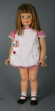 Patty PlayPal doll was made between 1959-1962. My sister and I both had one. I remember she wore a size 3T in clothes, so you could buy real clothes to dress her in. Mine looked just like this one, with the long reddish straight hair, and she wore black patent shoes. She stood about 3 ft tall.