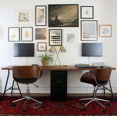 Two-person IKEA desk with Lerberg trestle legs and Karlby countertop. Wall-mounted monitors included in the gallery wall.