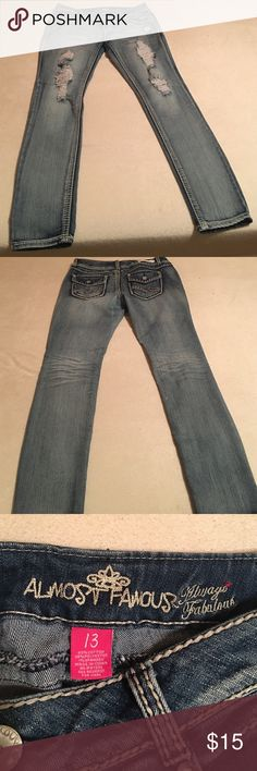 Ripped jeans! Light wash skinny jeans with rips down the front two legs. Silver rhinestones on back pockets. Worn once. Practically new! Almost Famous Jeans Skinny