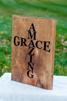 This is a handmade wood sign with this beautiful Amazing Grace in a cross shape. This sign is made out of a wood board, stained, and then has vinyl