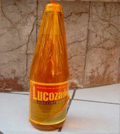 lucozade wrapped in orange crinkle paper - only ever had this when you were ill