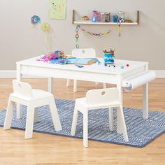 Small Adjustable White Activity Table | The Land of Nod. Adjustable legs, art and train table.