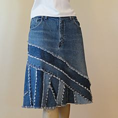 I think this looks really cool.... good upcycle for old jeans, especially if you embroider some funky designs in there, or paint on some of the pieces, do it up artsy and creative so you don't look like you are wearing denim for religious reasons, unless that is your thing, go for it!