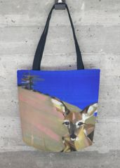 FAWN TOTE BAG  Print of acrylic painting with stylized nature scenery, animal theme, fawn lying on hillslope, blue sky above. This gorgeous all-over printed tote bag - made in California, United States - features sturdy, weather-resistant fabric and dual 100% natural cotton bull denim shoulder straps. Make a beautiful, artful statement with this stand out, all-season VIDA Tote Bag - whether on an afternoon stroll around town or a weekend out of town.