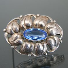 Floral Brooch, .835 silver with synthetic aquamarine. Denmark, ca. 1905-1915.