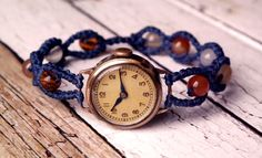 This is a macrame tutorial for a very simple watch band. It is knotted with a twisted half hitch and carnelian pearls.