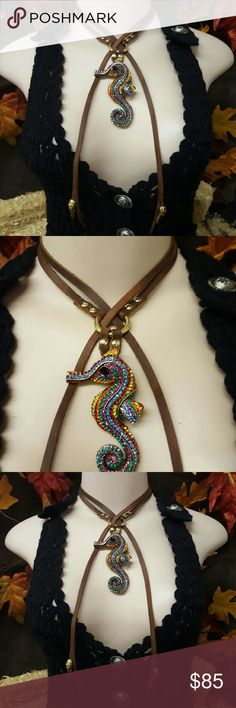 NEW ONE OF A KIND HAND MADE LEATHER WRAP CHOKER NEW ONE OF A KIND DESIGN HAND MADE LEATHER WRAP CHOKER. Soft brown sturdy leather. Gold detail. Embellished with full rhinestone colorful seahorse statement piece. Bohemian Cowgirl Collection! Creative Crystal Designs Jewelry Necklaces