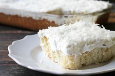 My Mom's Best Ever Coconut Cakeis dessert heaven! Creamy, dreamy, tender cake topped with whipped cream is so easy to make and is loaded with coconut flavor!