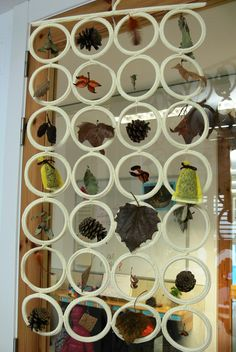 Exploring nature using things found through the seasons displayed on an Ikea scarf holder. Awesome idea!