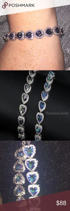 "Luxury CZ & Mystic Topaz 925Sterling Bracelet 🎀JUST IN🎀 Luxury CZ Diamond Jewelry Gift, your choice of Sparkling Blue Mystic Topaz or Mystic Topaz Heart Crystal 925 Sterling Silver 7.5"" Tennis Bracelet For Women. All boutique items final sale, no offers or trades. three graces Jewelry Bracelets"