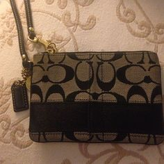 Coach wristlet Black Coach wristlet. In good condition. Smoke free home. Coach Bags Clutches & Wristlets