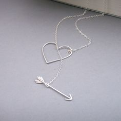 Heart and Arrow Necklace-this is an absolutely adorable idea-when the necklace is taught (on your neck, hanging) the arrow looks like it's going right through the heart!