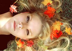 blonde model posing with arranged leafs on her hair