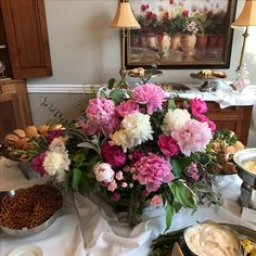 Peonies, mint, lambs ear and mixed greens in brass pedestal container.