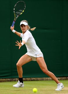 Eugenie Bouchard Photos Photos - Eugenie Bouchard of Canada hits a forehand during her Ladies' Singles third round match against Carla Suarez Navarro of Spain on day five of the Wimbledon Lawn Tennis Championships at the All England Lawn Tennis and Croquet Club on June 28, 2013 in London, England. - Wimbledon Tennis Championships: Day 5