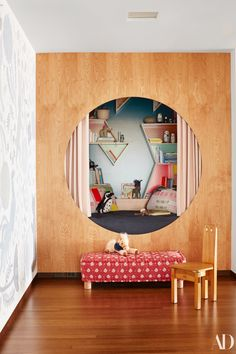 Tour the Sittig's Eclectic Hillside Home in San Francisco Glimpsed through a porthole the reading nook is decorated with Benjamin Moore and Pratt Lambert paints vintage textiles.