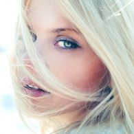 A light breeze off the Mendocino bluff swirled her blond hair across the right side of her face obscuring that eye almost completely.