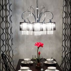 Glam up your front hallway with this crystal five-light chandelier. This lovely fixture will illuminate your space with its five bulbs, and its gorgeous crystals will glimmer in the light and add an extra touch of elegance to your decor.