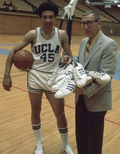 This image from Sports Illustrated shows John Wooden and Henry Bibby of the UCLA Bruins sporting the Adidas look. Cal Basketball, Basketball Equipment, Basketball History, Love And Basketball, Basketball Legends, College Basketball, Basketball Stuff, Notre Dame Campus, College Hoops