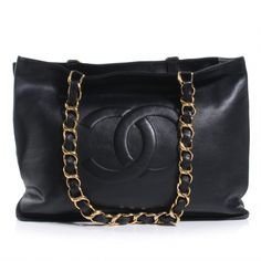 CHANEL Vintage Calfskin Jumbo Shoulder Bag in Black.This stylish vintage shoulder bag is crafted of soft and smooth leather with a prominent stitched Chanel CC logo at the front with oversized gold chain link shoulder straps threaded with black leather.