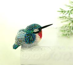 I admire beadwork.......  Hummingbird Miniature Figurine Beaded Animal Totem by MeredithDada, $42.00