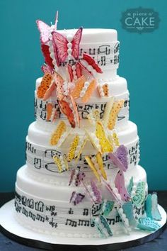 Rainbow butterflies against a musical theme...by A Piece O' Cake. Elena's first birthday cake???