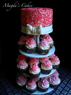Pink sprinkles cupcake tower. I love the idea of a small sprinkles cake on top!