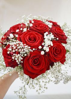 A beautiful bouquet of Red Roses and Gypsophila.